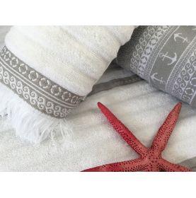 serviettes de bain taupe et blanches avec des franges
